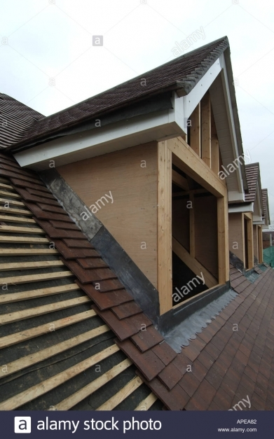 Fascinating Row Of Three Dormer Windows Being Built Into Roof Of A New Dormer Window Roofs Photos